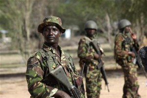 Kenyan troop stand guard at the Garrisa airstrip near the Somali-Kenyan border